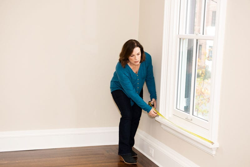 Nancy measuring a window